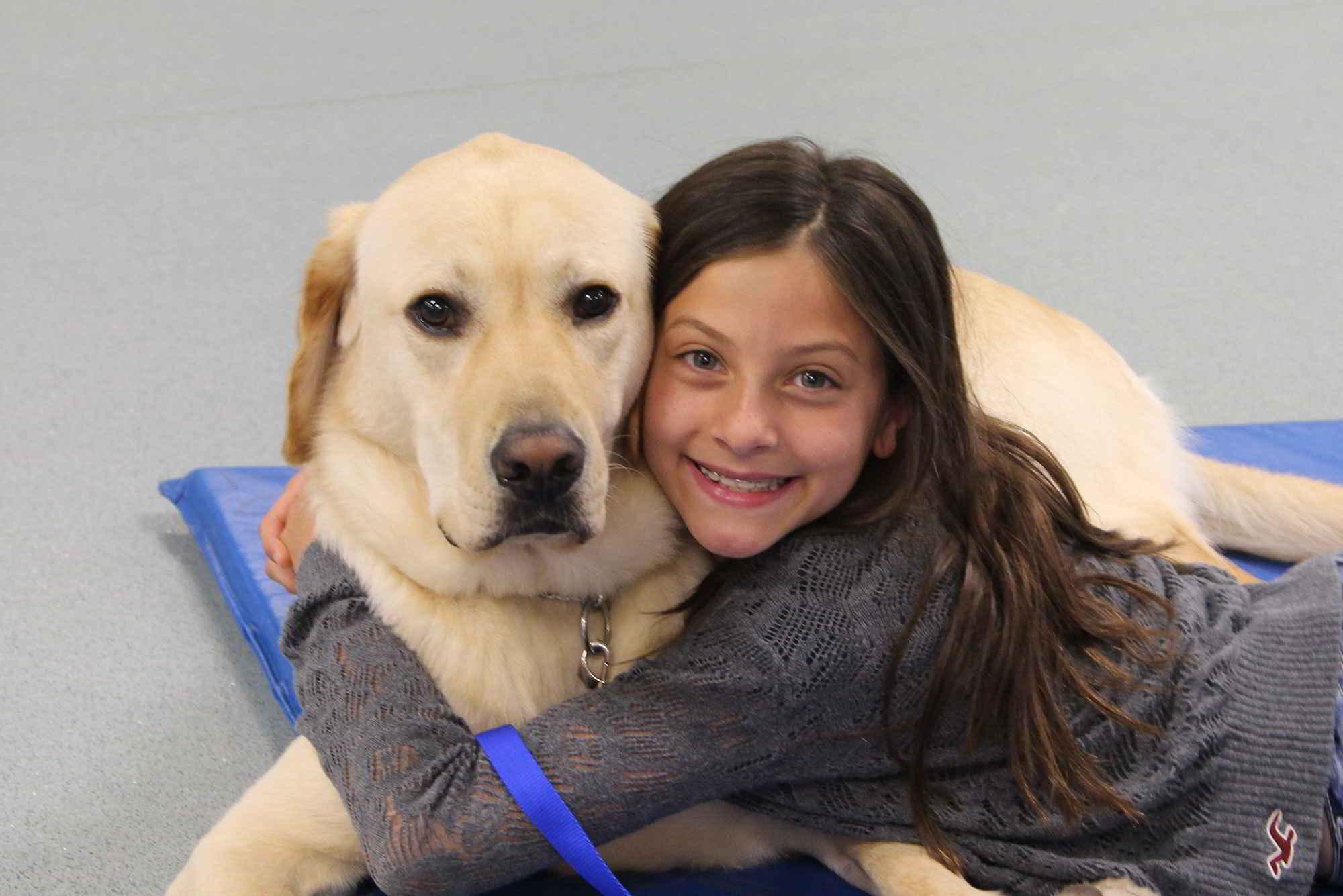 LanDan Olivia et son chien d'assistance Perkins