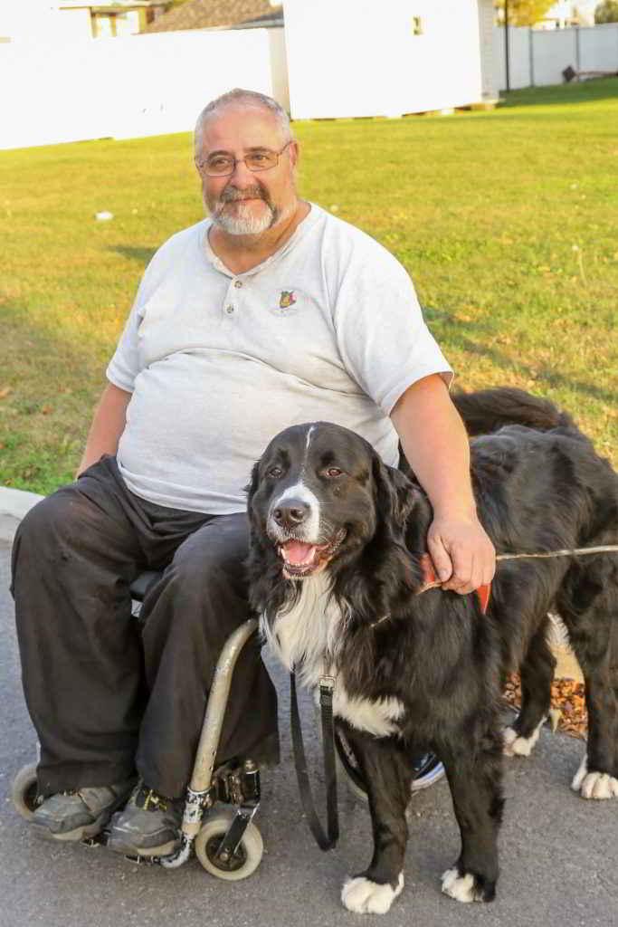 Jacques et son chien d'assistance