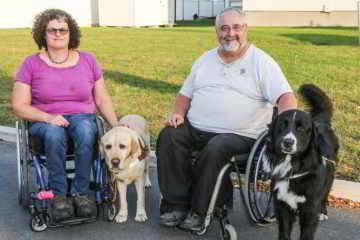 Jacques et Sylvie et leurs chiens d'assistance