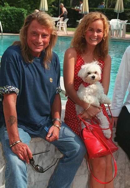 Johnny, Laeticia et leur bichon Lucas